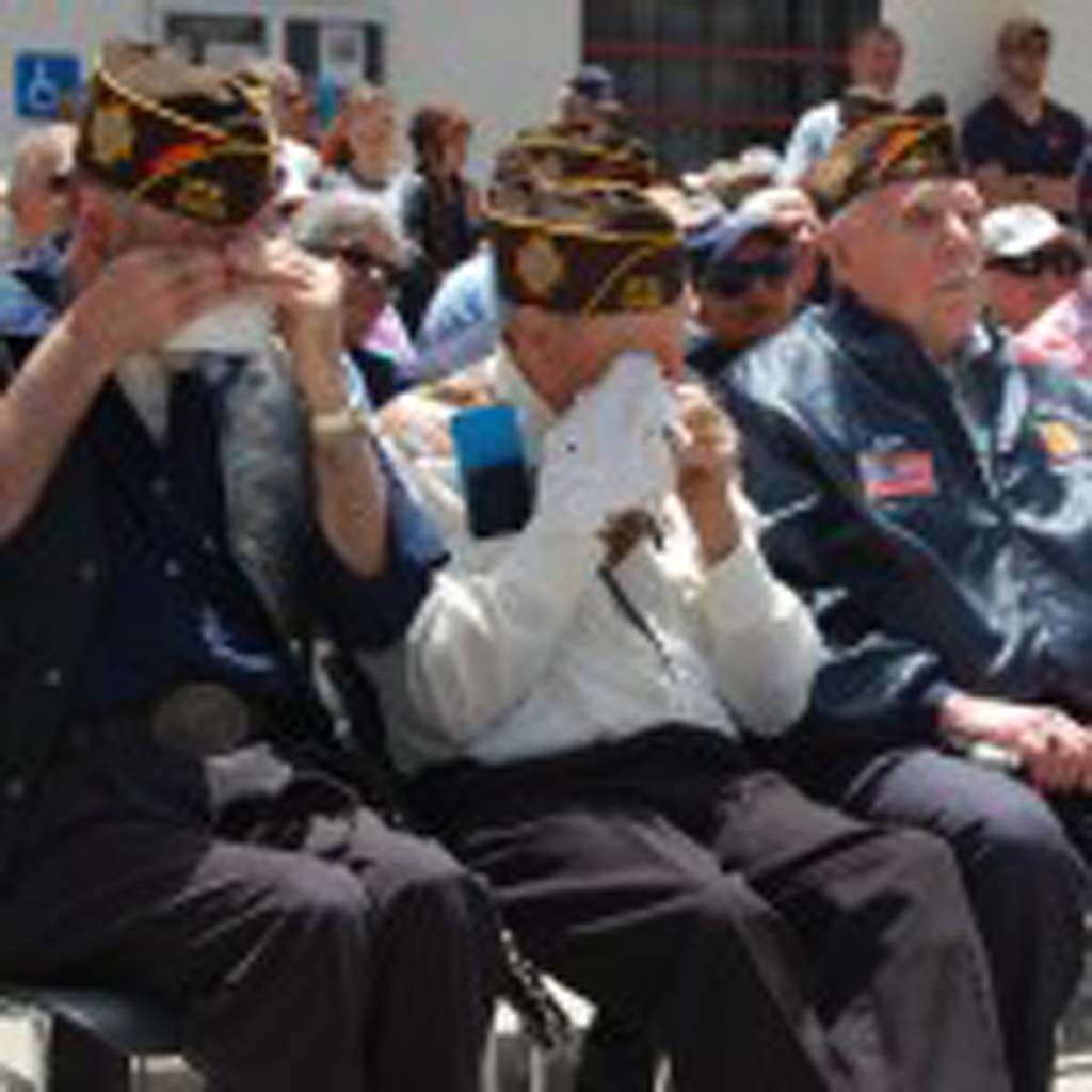 """Steve Ellwood, George Townsend and Jack Fletcher respond as guest speaker David Jacinto thanks servicemen and women for """"laying their lives on the line to do the work that needs to be done to preserve liberty worldwide."""" Photo by Bianca Kaplanek"""