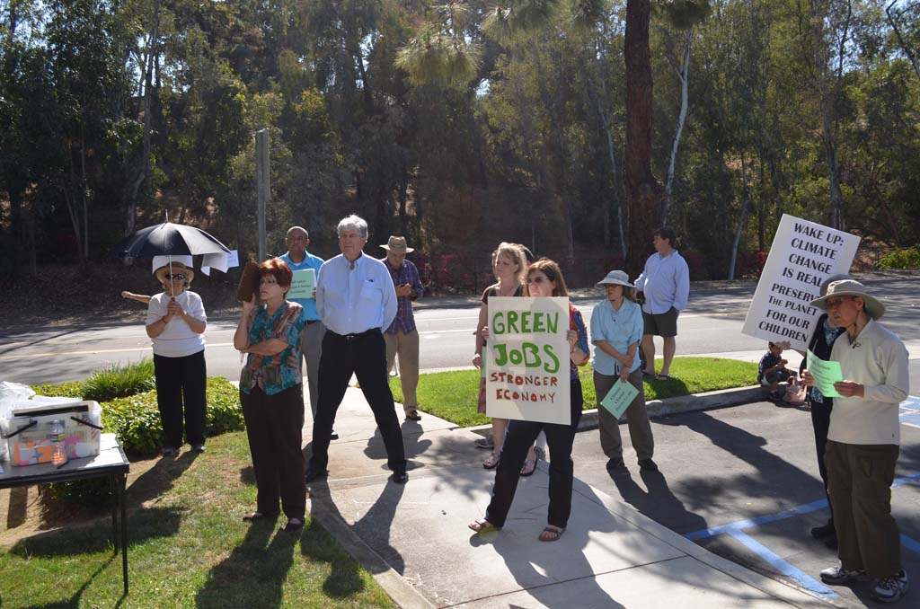 Residents that form part of the local chapter of Organizing for Action gather outside of 49th Congressional District representative Darrell Issa's office in the hopes of talking about climate change. Photo by Jared Whitlock