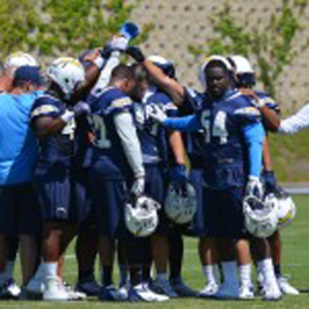 The Chargers defensive unit huddles up at the break of OTAs Monday. Photo by Tony Cagala