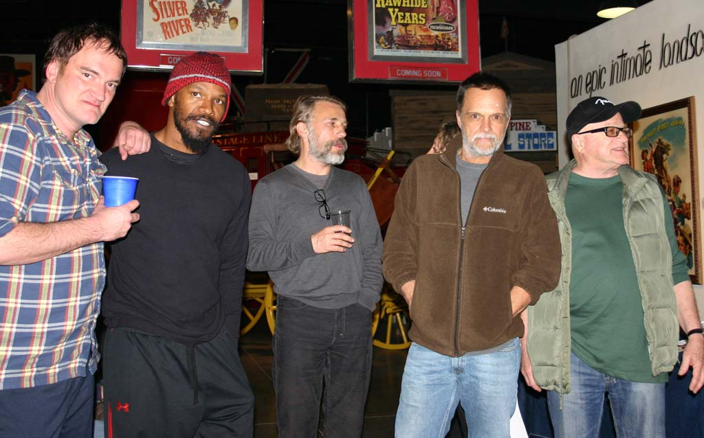 """The cast of """"Django Unchained"""" relaxed at the Lone Pine Film History Museum during filming in 2011. From left: director Quentin Tarantino; actors Jamie Foxx, Christoph Waltz and James Russo; and Inyo Film Commissioner Christopher Langley. Photo courtesy of the Lone Pine Film History Museum"""