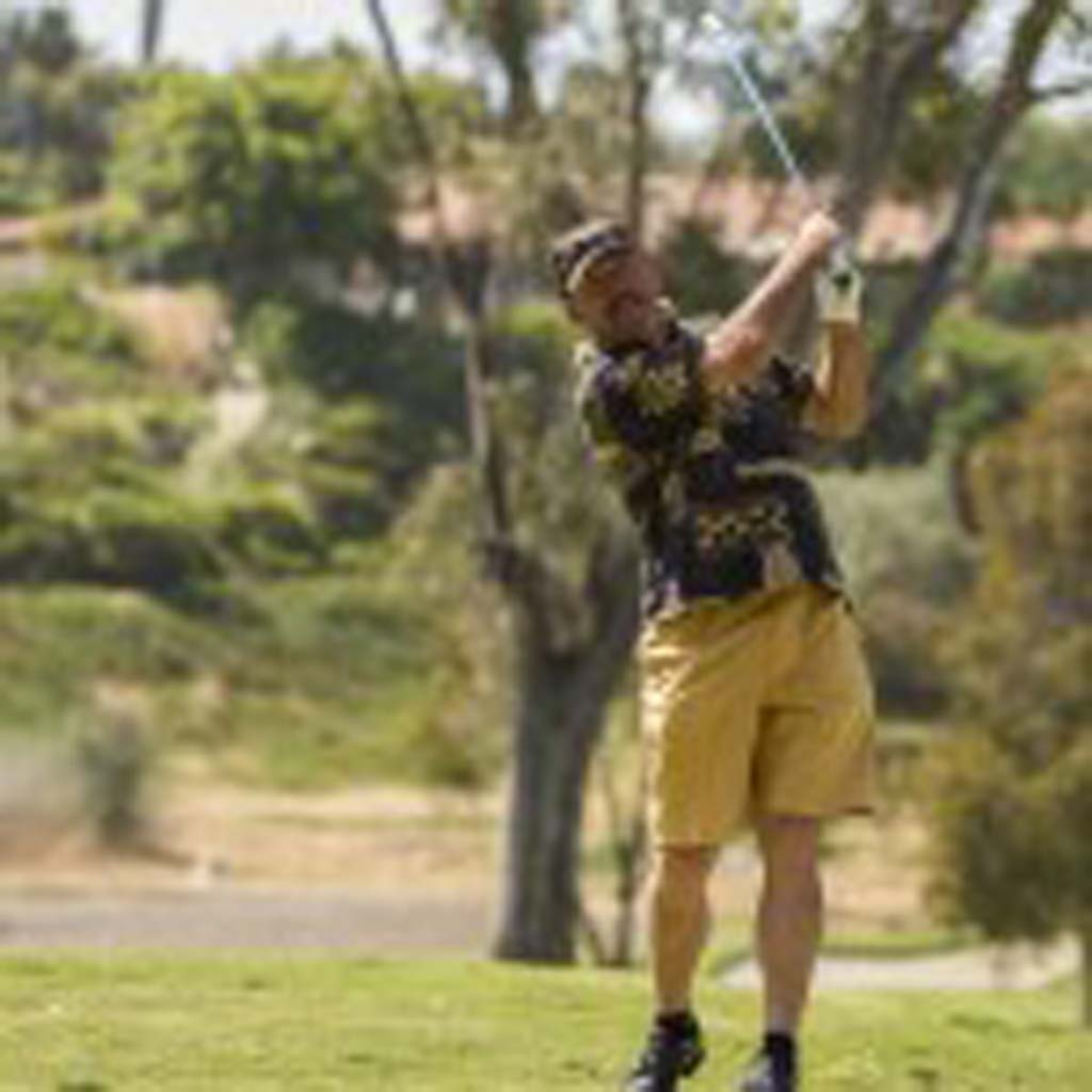 Former San Diego Padres player and La Costa resident Kurt Bevacqua tees off on the third hole at the Celebrity Championship golf tournament. Photo by Daniel Knighton