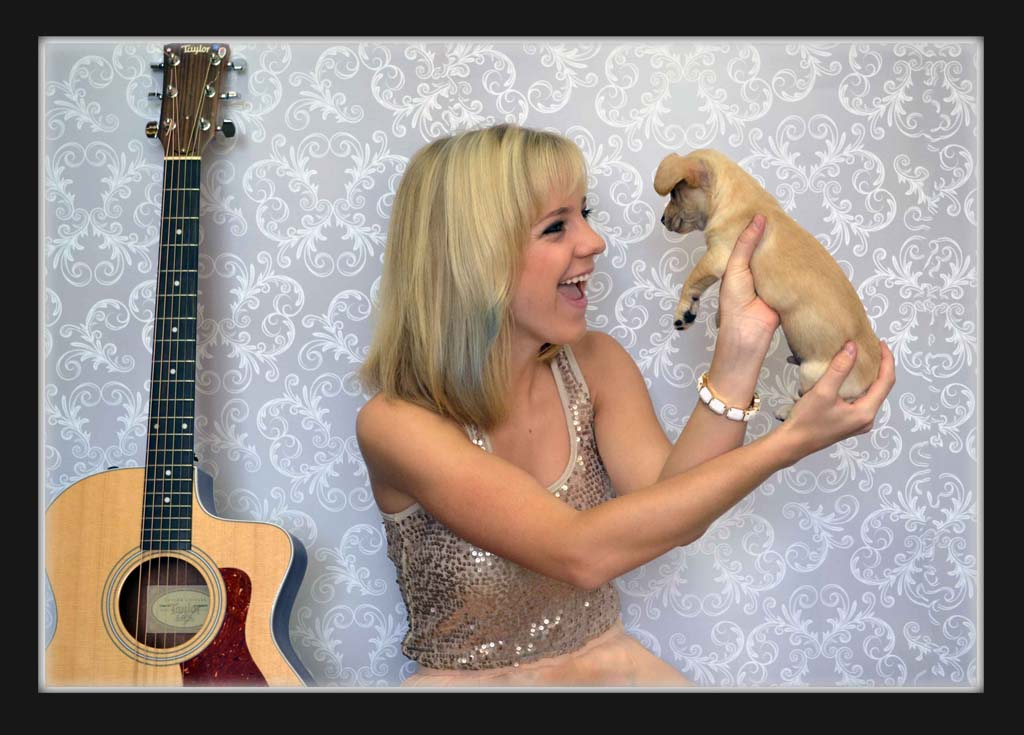 American Idol Contestant/Spring Fling Performer Kristi Krause meets a Helen Woodward Animal Center adoptable pup. Krause will perform at the upcoming fundraiser June 1 in Rancho Santa Fe. Courtesy photo