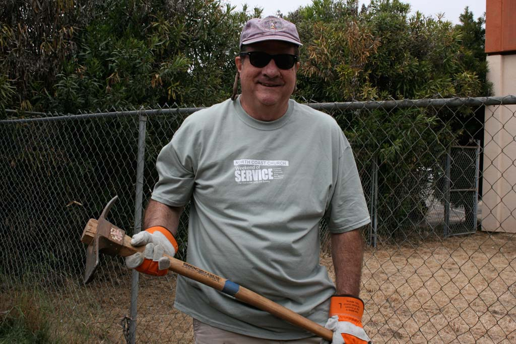 Volunteer Steve Murphy joined close to 7,000 fellow volunteers in a weekend of service organized by North Coast Church April 27 and 28. Six unwanted tree and yards of weeds and bushes were removed from Oceanside Boys and Girls Club property as part of the project.