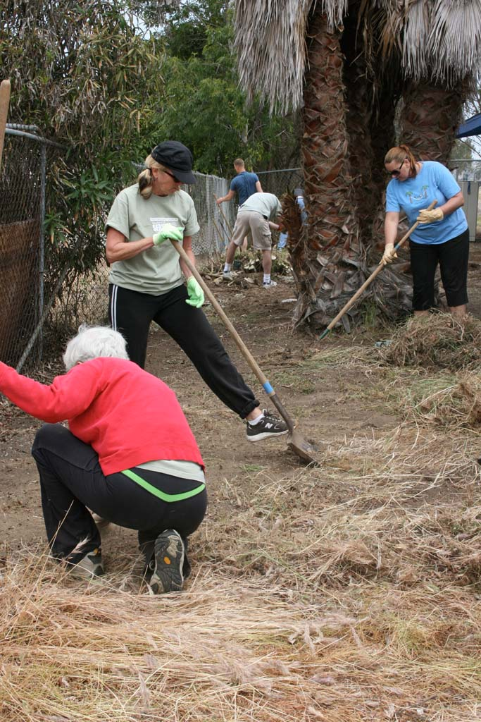North Coast Church volunteers dig in to remove invasive weeds from Oceanside Boys and Girls Club property. A total of 250 community improvement projects were completed in North County during the weekend of service.