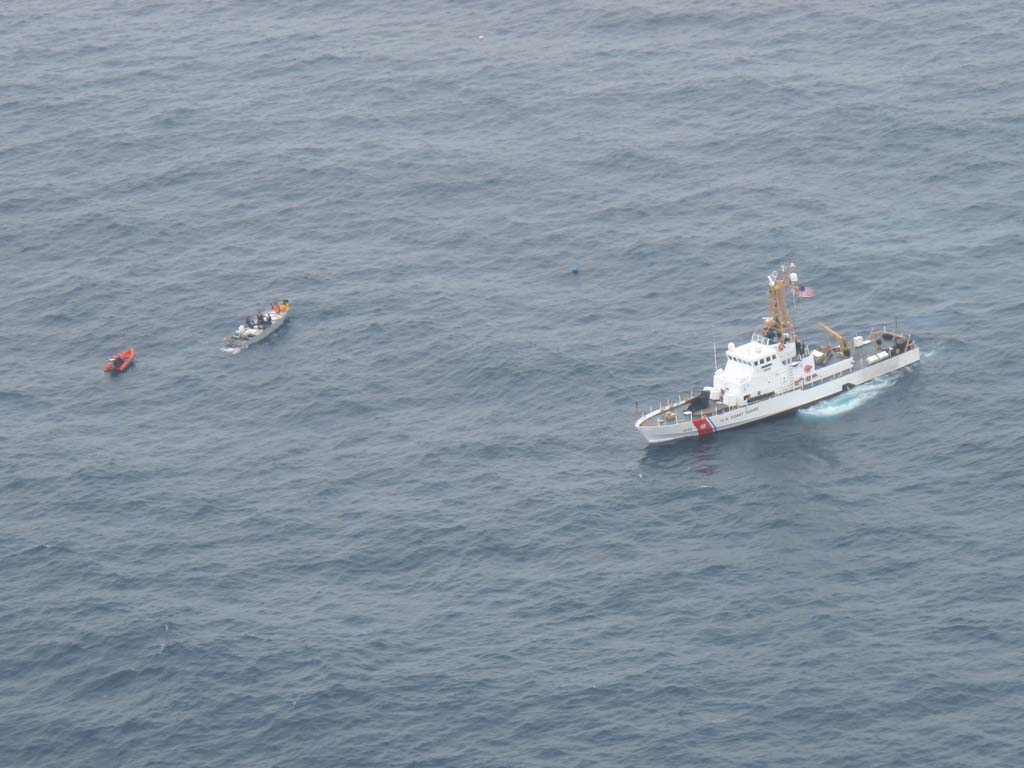 A boarding team deployed from U.S. Coast Guard Cutter Edisto approaches a suspected smuggling boat approximately 100 miles southwest of San Diego on June 18. The boat, its three passengers and the contraband were handed over to the Mexican navy for further enforcement action. Photo courtesy of U.S. Coast Guard by Air Station Sacramento