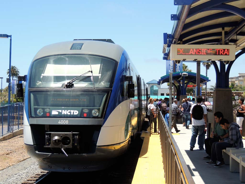 Passengers leave and board a NCTD Sprinter train at the Oceanside Transit Center. Currently only two trains can board simultaneously at the Center, but a SANDAG and NCTD improvement project will allow up to three trains to board at the same time. Photo by Rachel Stine
