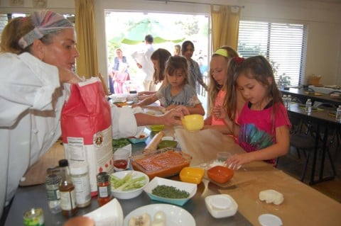 Oprah's former chef gets cooking with local children