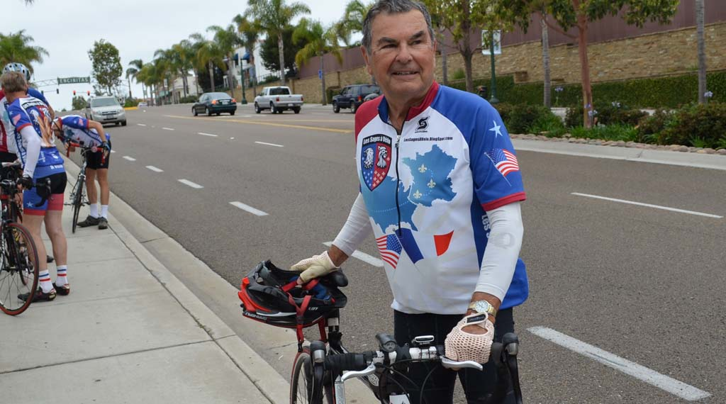 Pierre Godefroy, who earned a proclamation for bicycling and community service, stands on Coast Highway 101. He credits cycling with aiding him in transitioning to retirement. Photo by Jared Whitlock