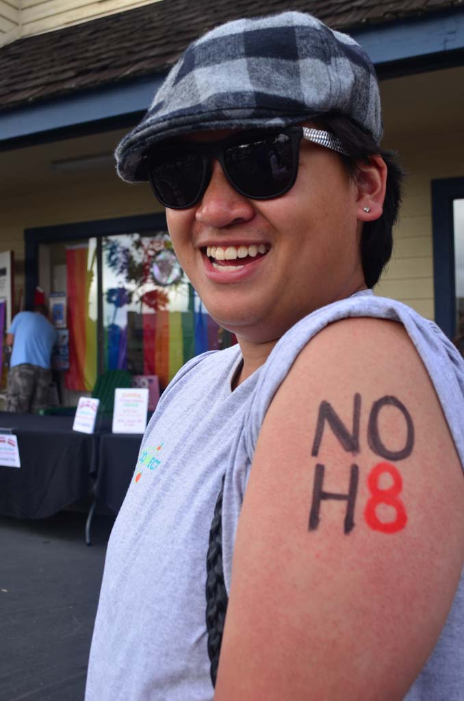 Brett Llevado celebrates at the North County LGBTQ Resource Center Wednesday. Photo by Tony Cagala