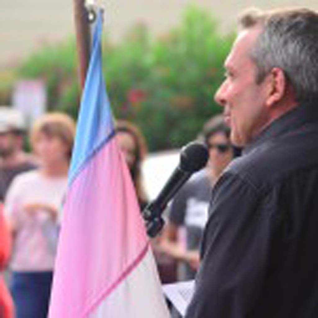 "Executive Director of the North County LGBTQ Resource Center Max Disposti rallies the crowd Wednesday following the rulings issued by the U.S. Supreme Court on same-sex marriage. He says they still have ""a lot of work to do."" Photo by Tony Cagala"