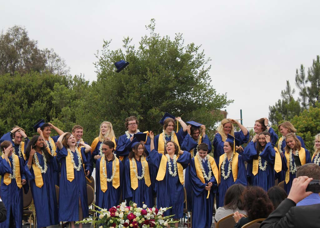 The Grauer School Class of 2013 throws mortarboard caps into the air upon graduation. Photo/ Traci Kitaoka