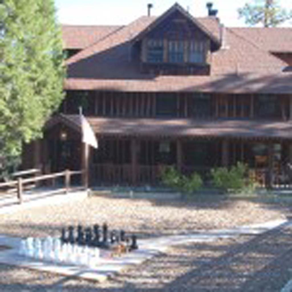 "The Knickerbocker Mansion, built in the early 1900s, is an intricate part of the history of the Big Bear area. It was constructed by William Knickerbocker, a woodsman who arrived in the region in 1901 to mine for gold. Tales about ""Knick"" rival those of Paul Bunyan. The bed-and-breakfast is just a few blocks from the heart of the town of Big Bear Lake. [Photo by Jerry Ondash]"