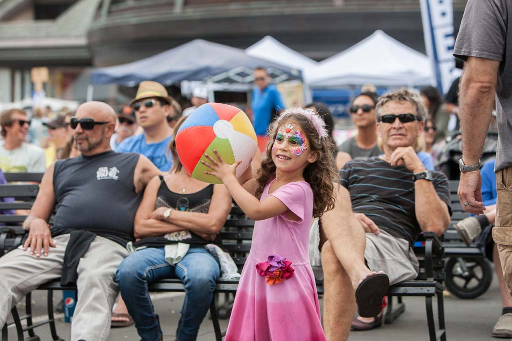4-year-old Carmel Valley resident Anika Gamburg plays with her beach ball at Fiesta Del Sol. Photo by Daniel Knighton