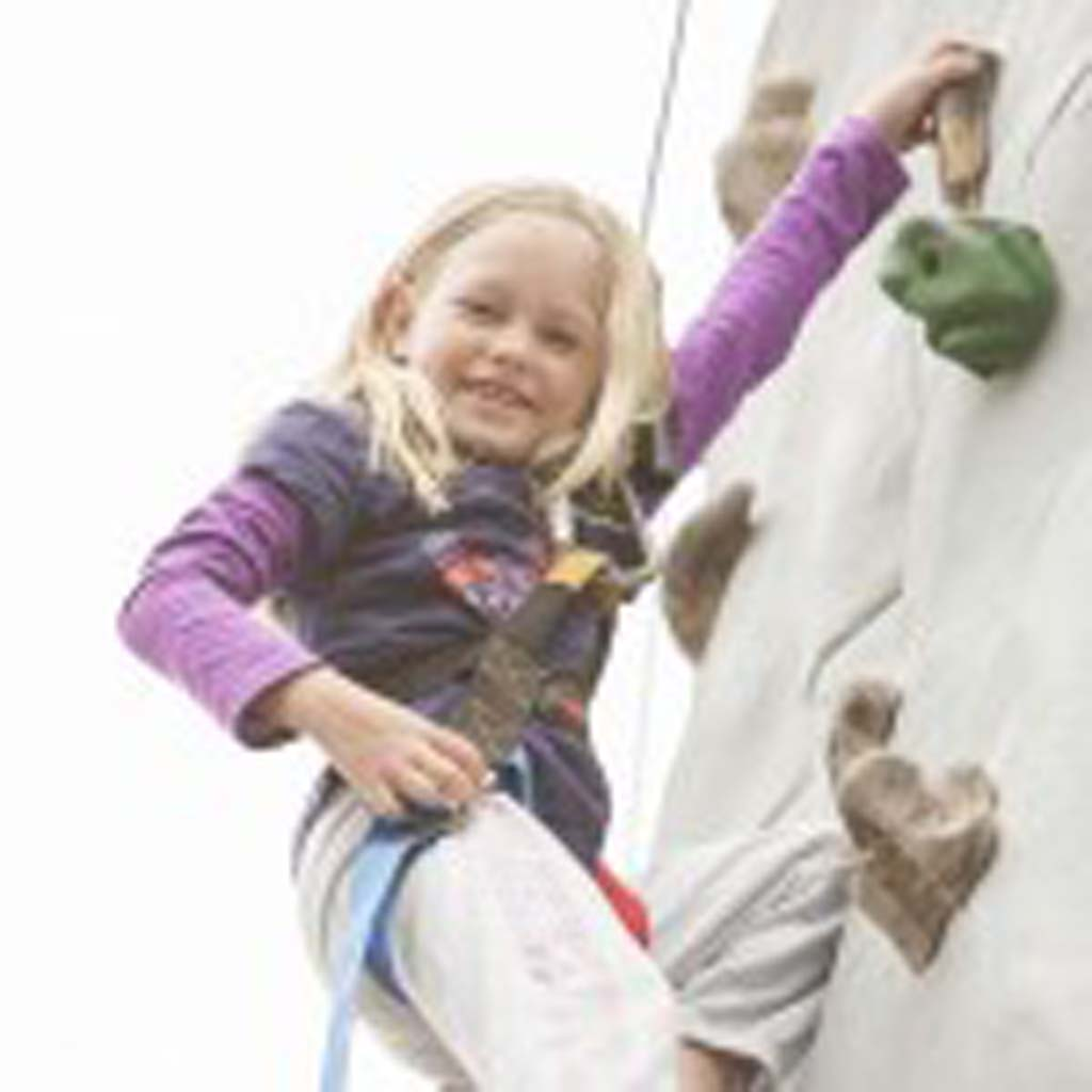7-year-old Solana Beach resident Ellery Dinsmore makes her way to the top of the rock climb. Photo by Daniel Knighton