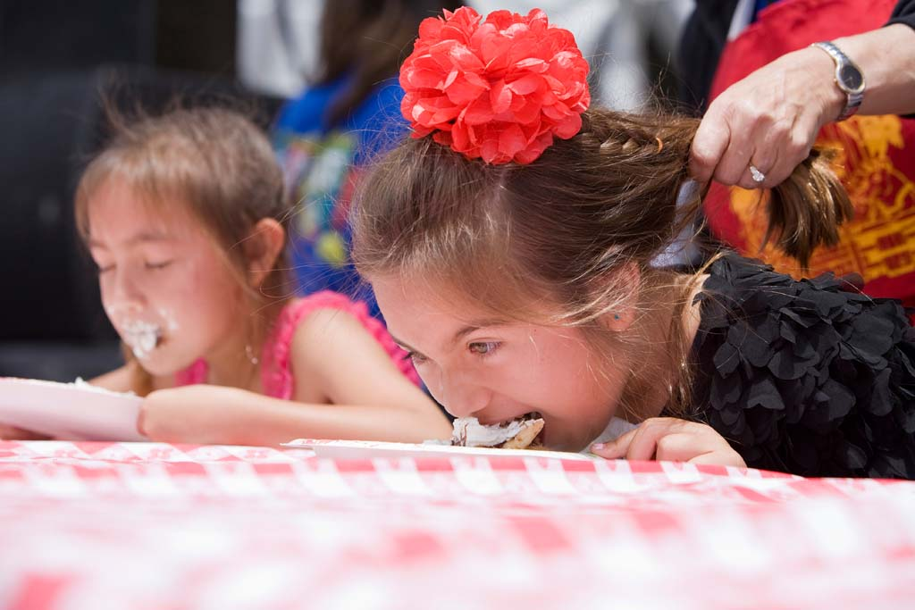 San Diego residents 7-year-old Annabelle Marquez and her sister, 6-year-old Ruby Marquez tied for 2nd place in the Coco's Pie Eating Contest. Photo by Daniel Knighton