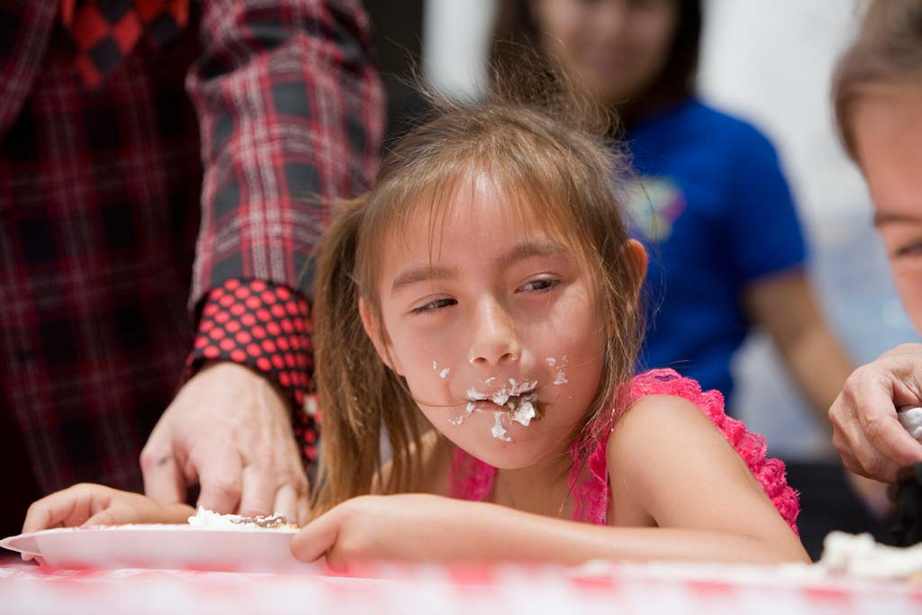 6-year-old San Diego resident Ruby Marquez tied for 2nd place in the Coco's Pie Eating Contest with her sister on opening day. Photo by Daniel Knighton