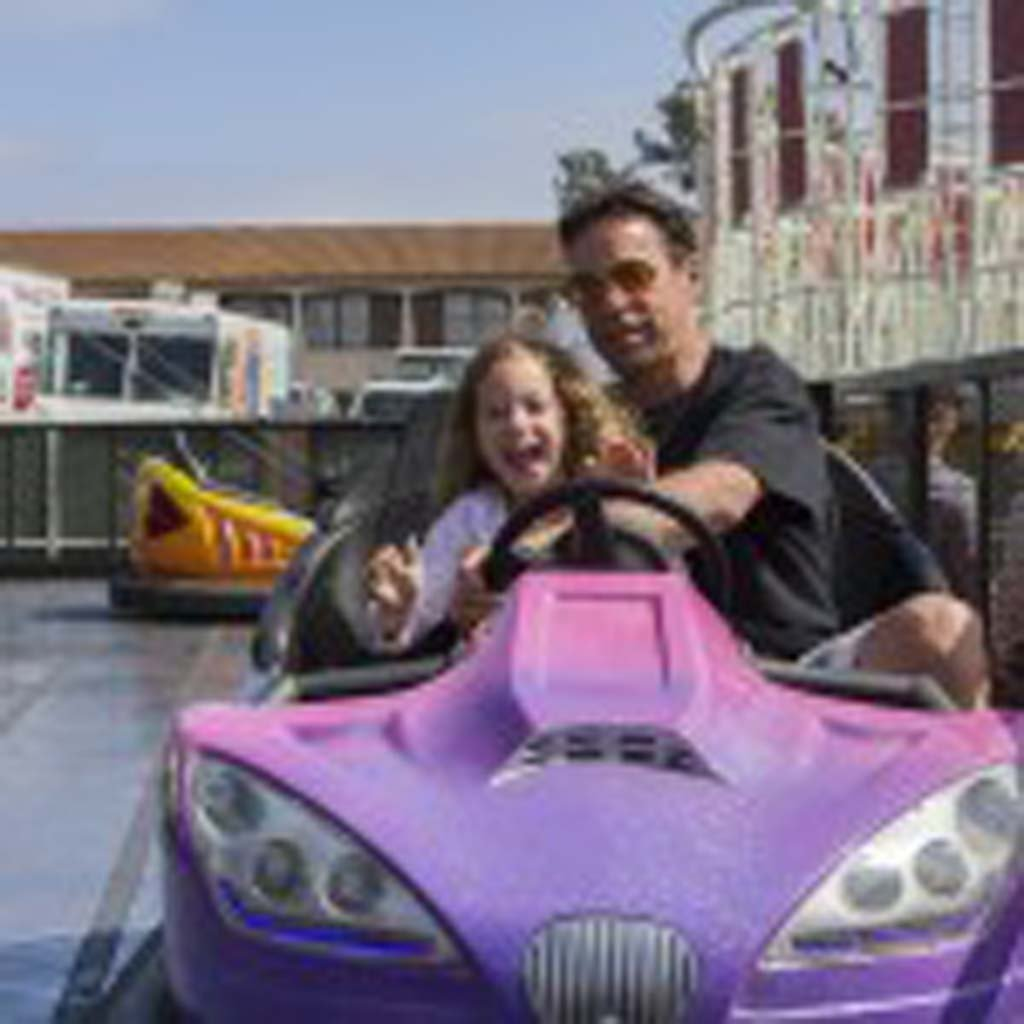 Solana Beach residents Ian Lazarus and his daughter Emmalee take a spin in the bumper cars. Photo by Daniel Knighton