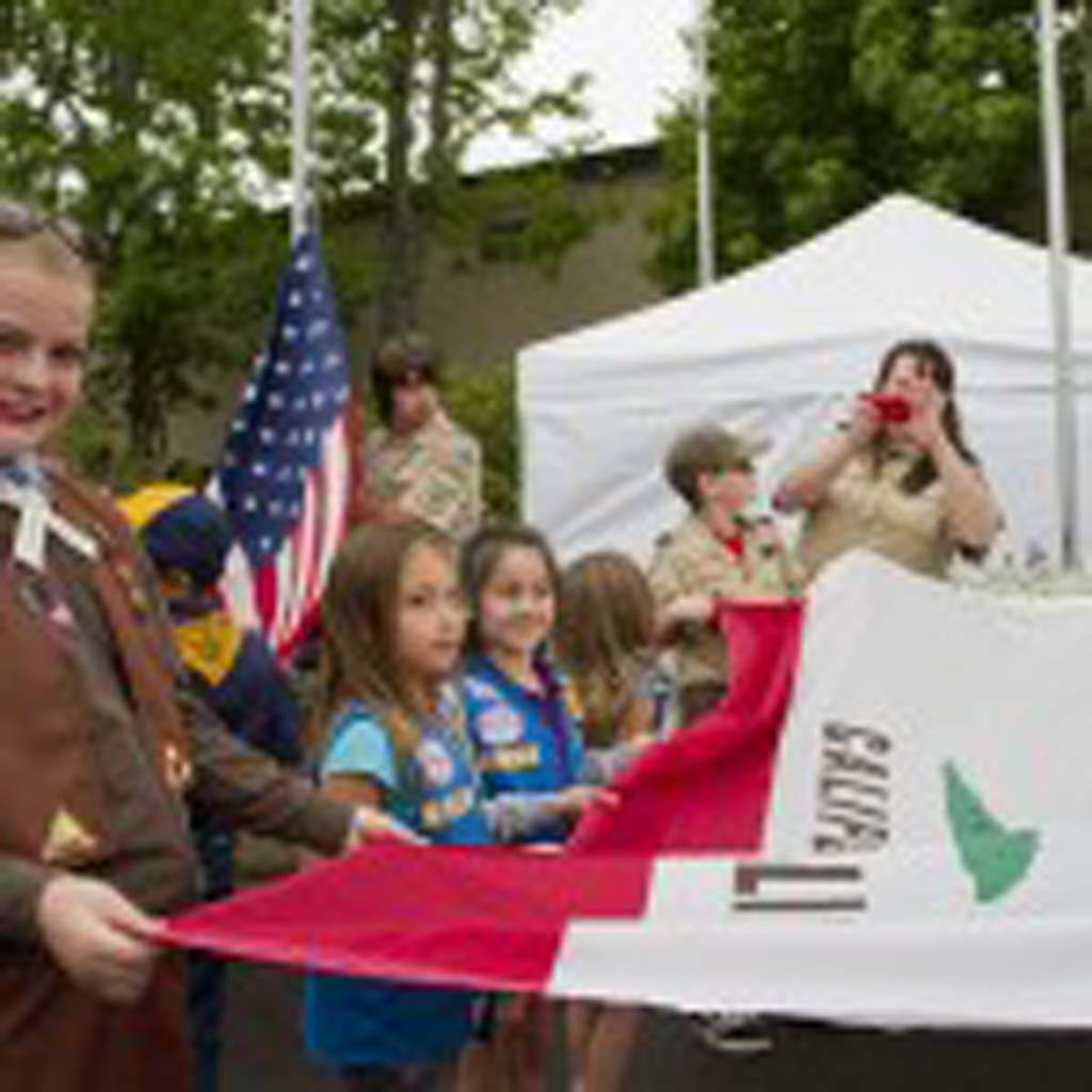 Santee resident Mallory Carrant assists with the flag raising ceremonies on opening day. Photo by Daniel Knighton