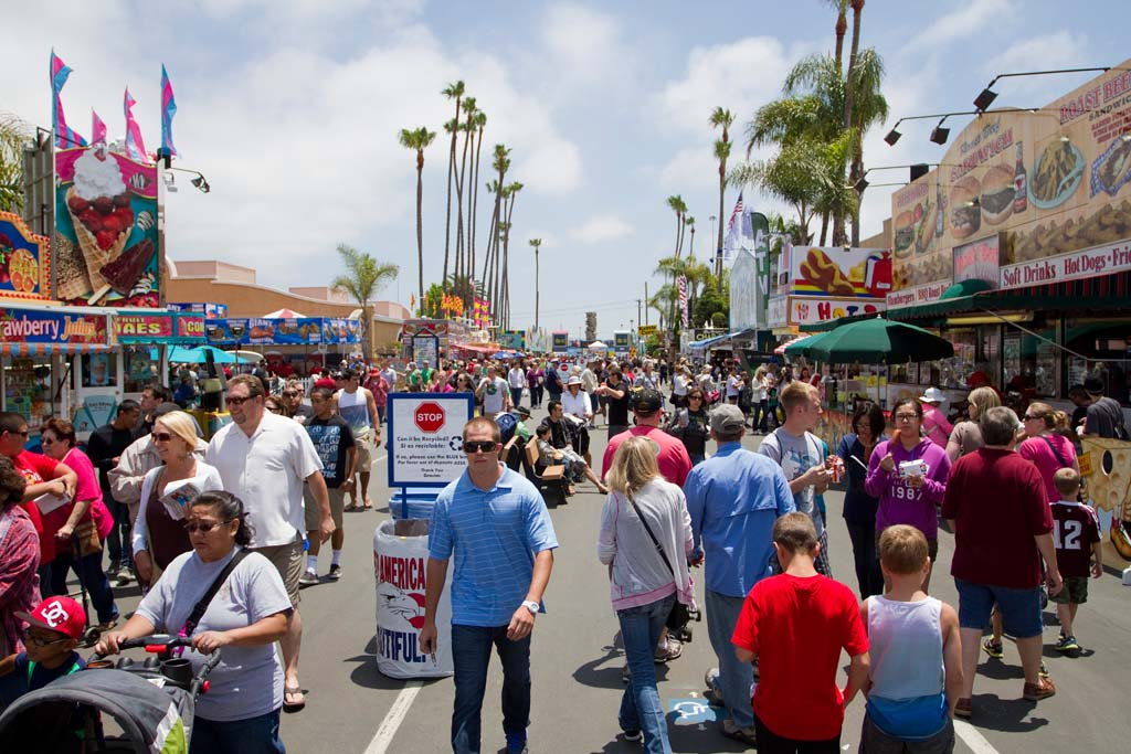 Visitors make their way down the Midway on opening day at the San Diego County Fair in Del Mar. Photo by Daniel Knighton