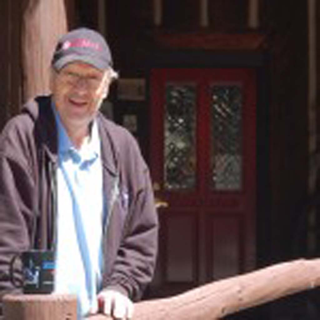 Stan Miller, owner of the Knickerbocker Mansion Bed & Breakfast in Big Bear Lake, felt compelled to save the historic log home when it was threatened by foreclosure and destruction. The long-time sound engineer welcomes guests when he's not on the road with singer Neil Diamond and other big-name artists. [Photo by Jerry Ondash]