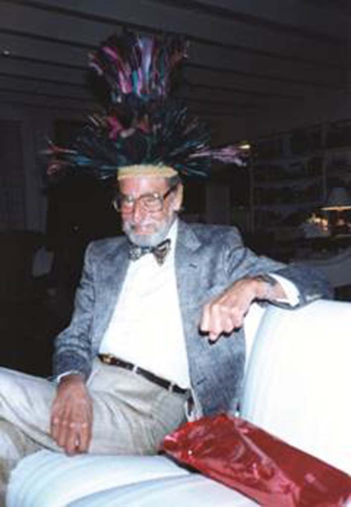 "Theodore Geisel, aka Dr. Seuss dons one of the hats from his famous hat collection that inspired ""The 500 Hats of Bartholomew Cubbins."" The collection will be on display in La Jolla in July. Courtesy photos"