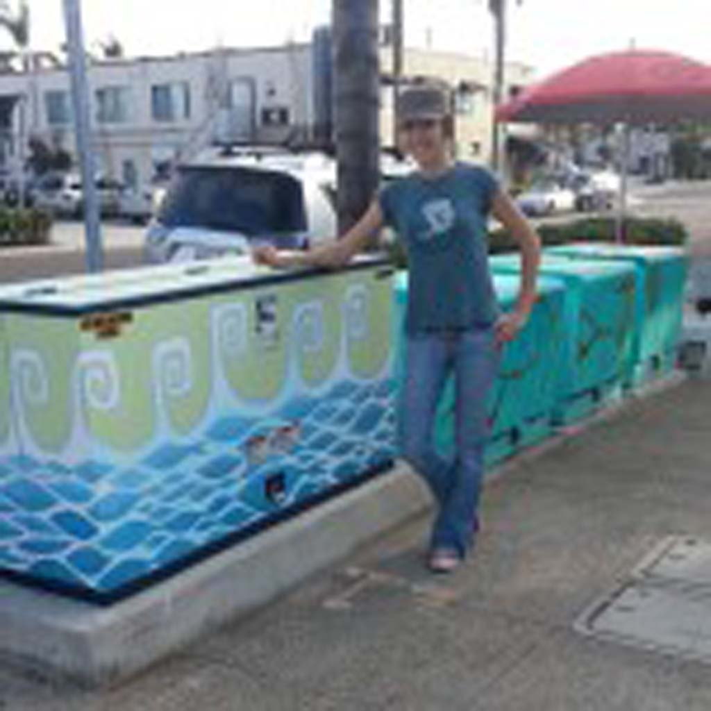 "Artist Monika Whisenhunt is one of three local artists chosen to paint electrical boxes, as part of Phase One for Encinitas 101 MainStreet's Utility of Art Project. She chose to create ""Happy Waves – Aquarium."" Courtesy photos"