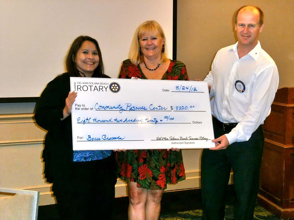 From left, Suzie Colby, director of Public Relations and Development, with Executive Director of the Community Resource Center Laurin Pause, received the first of several checks totaling $16,800 during the Rotary year from Ken Barrett, Rotary's community service chairman. Courtesy photo