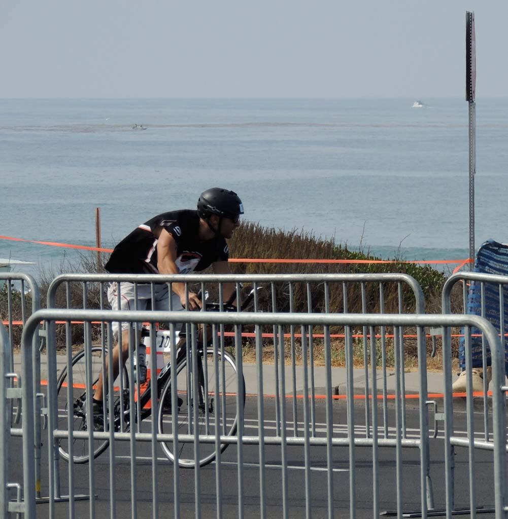 Oceanside resident Stephen Brandon, 31, petals to the finish of the bicycling portion of the triathlon. Photo by Rachel Stine