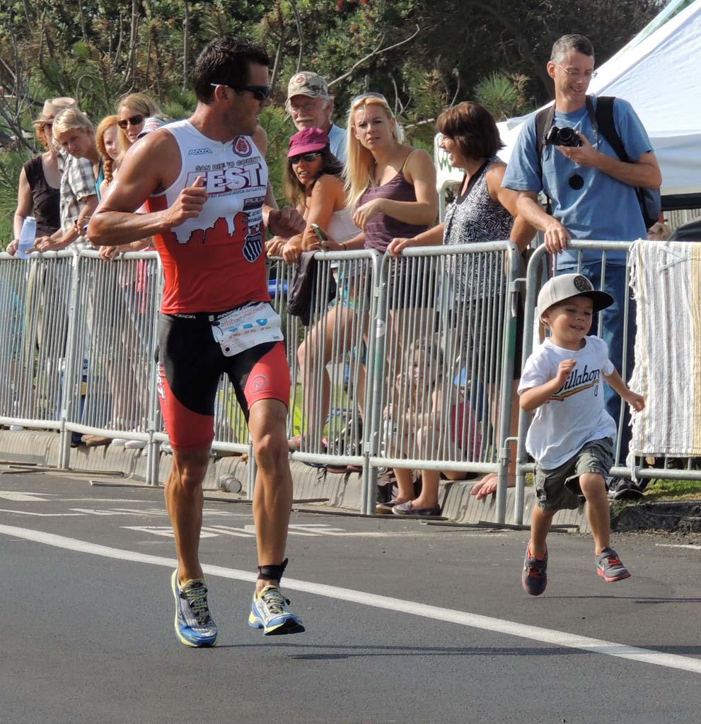 One athlete's son joins him on his last few steps towards the finish line. Photo by Rachel Stine