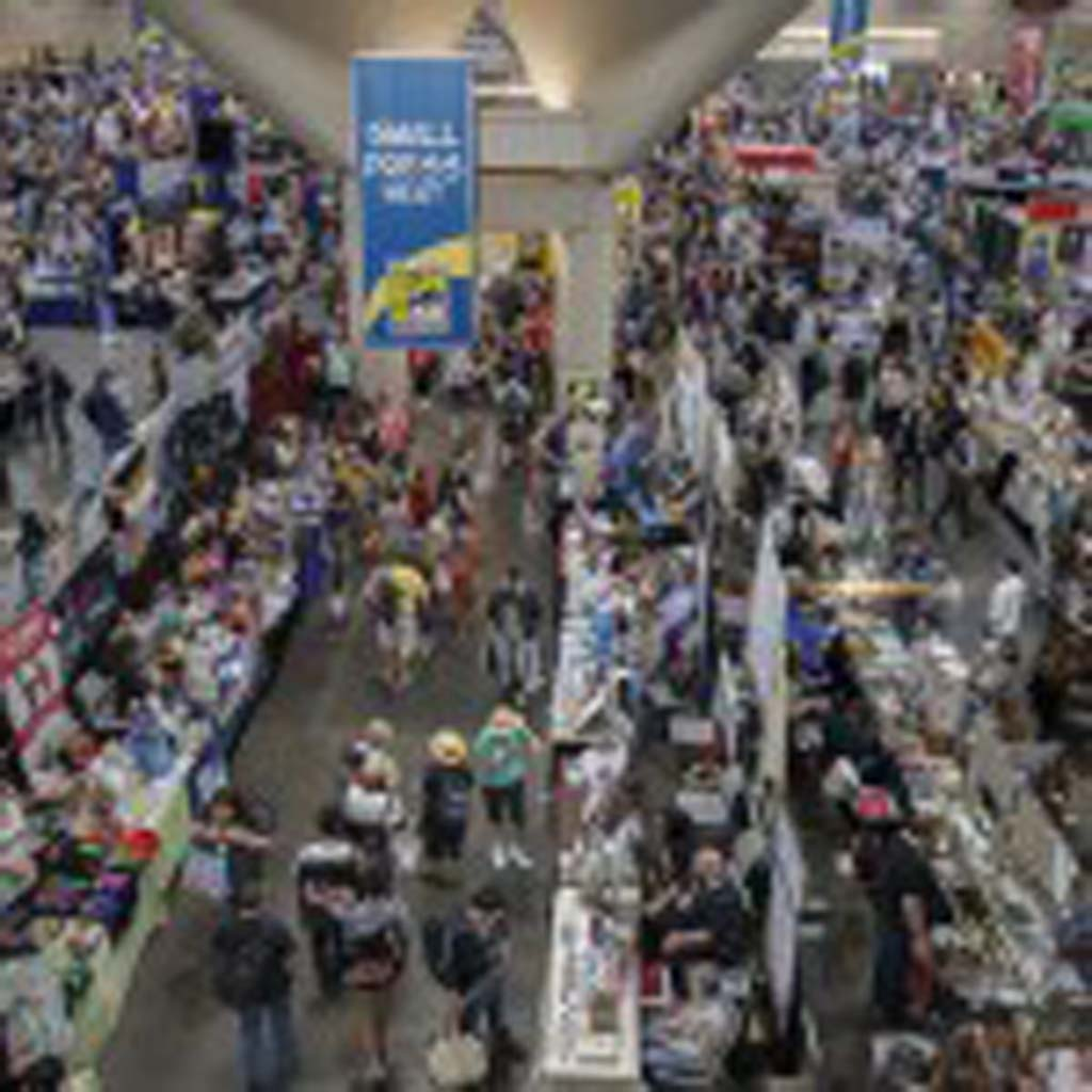 Fans pack the exhibit hall at Comic-Con on Thursday. Photo by Daniel Knighton