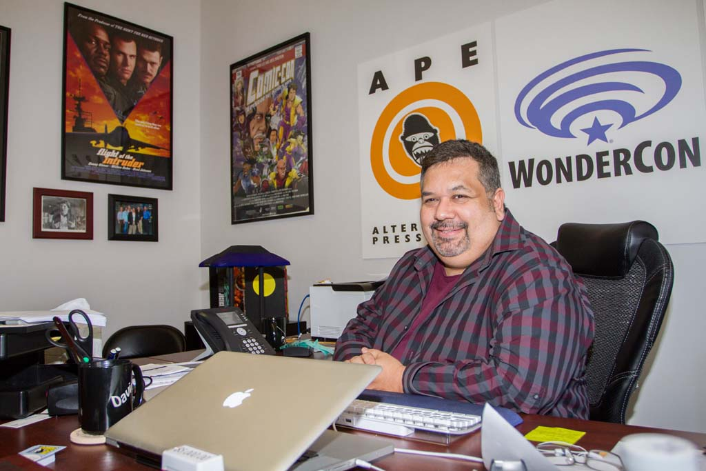 Comic-Con International Director of Marketing and Public Relations David Glanzer poses in his downtown office as he prepares this year's upcoming convention. Photo by Daniel Knighton