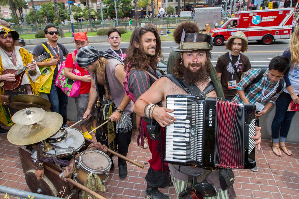 A band of street musicians dressed as pirates and playing the Star Wars bar theme entertains fans outside Comic-Con. Photo by Daniel Knighton