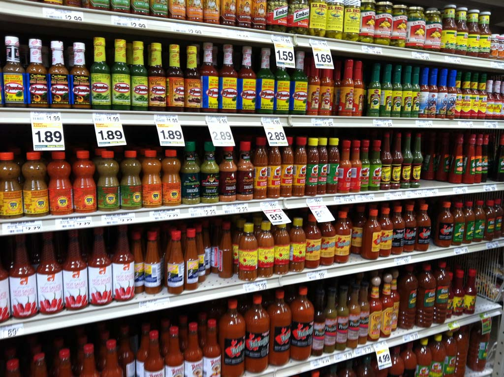 Dozens of different brands of salsa and hot sauce line the shelves at the recently opened Northgate Market in Barrio Logan (1950 Main St.; corner of Cesar Chavez Parkway and Main Street). The market offers an array of unique produce not often found in other markets, freshly baked breads and pastries, a butcher and a tortilleria. The lunch crowd can enjoy al fresco dining with food from the cafeteria, which serves generous, affordable portions of authentic Mexican food made daily on site. [Photo by E'Louise Ondash]
