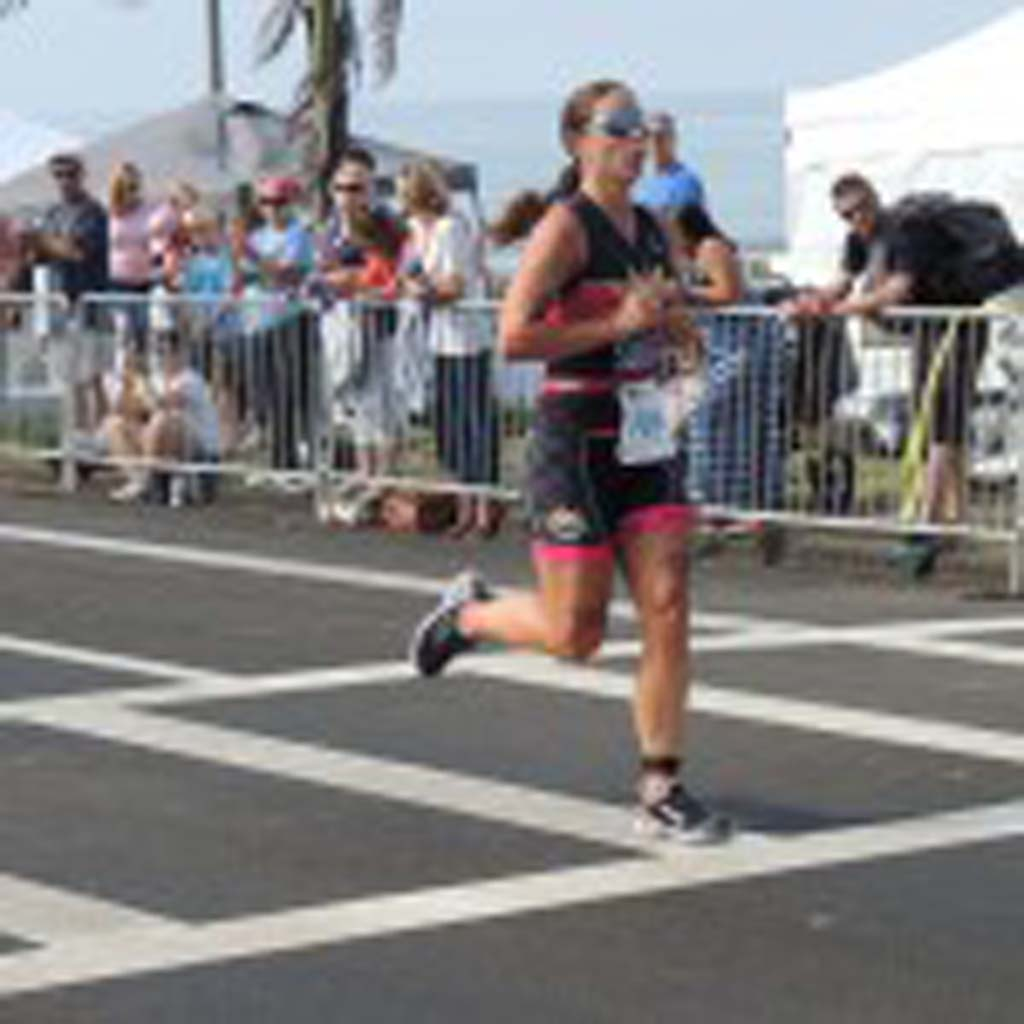 Carlsbad resident Megan Sullivan, 23, finishes third among the female competitors to complete the Carlsbad Triathlon. Photo by Rachel Stine