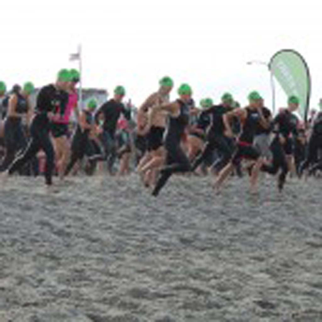 One women's division sprints towards the water, starting the Carlsbad Triathlon just after 8:30 a.m. Photo by Rachel Stine