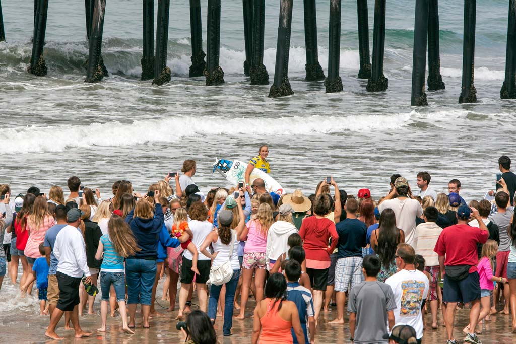 Bethany Hamilton from Hawaii exits the water to the cheers of the crowd after competing in Heat 6. Photo by Bill Reilly