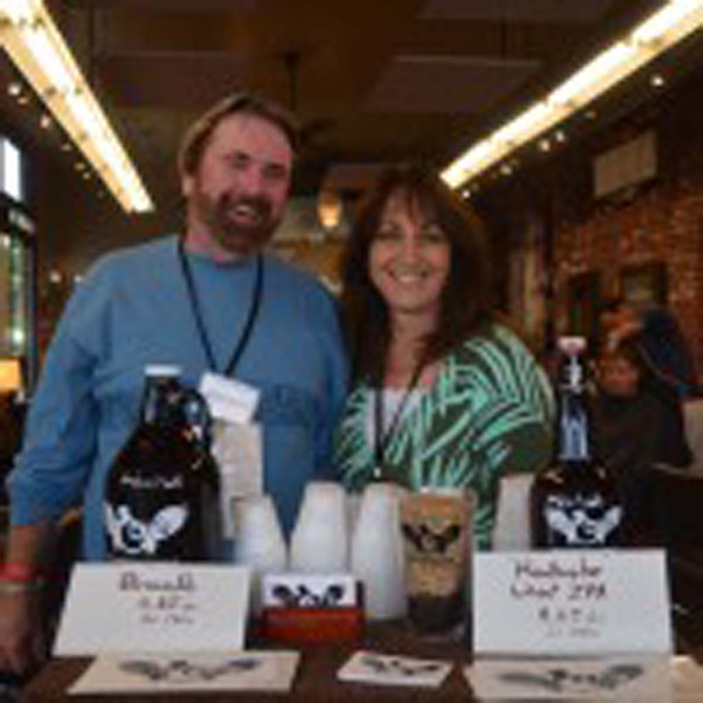 Tom Vogt, left, and Brenda Smith with Arcana Brewery, based in Carlsbad, host a sip station inside Detour Salon, offering samples of the brewery's India Pale Ale and Brown Ale.