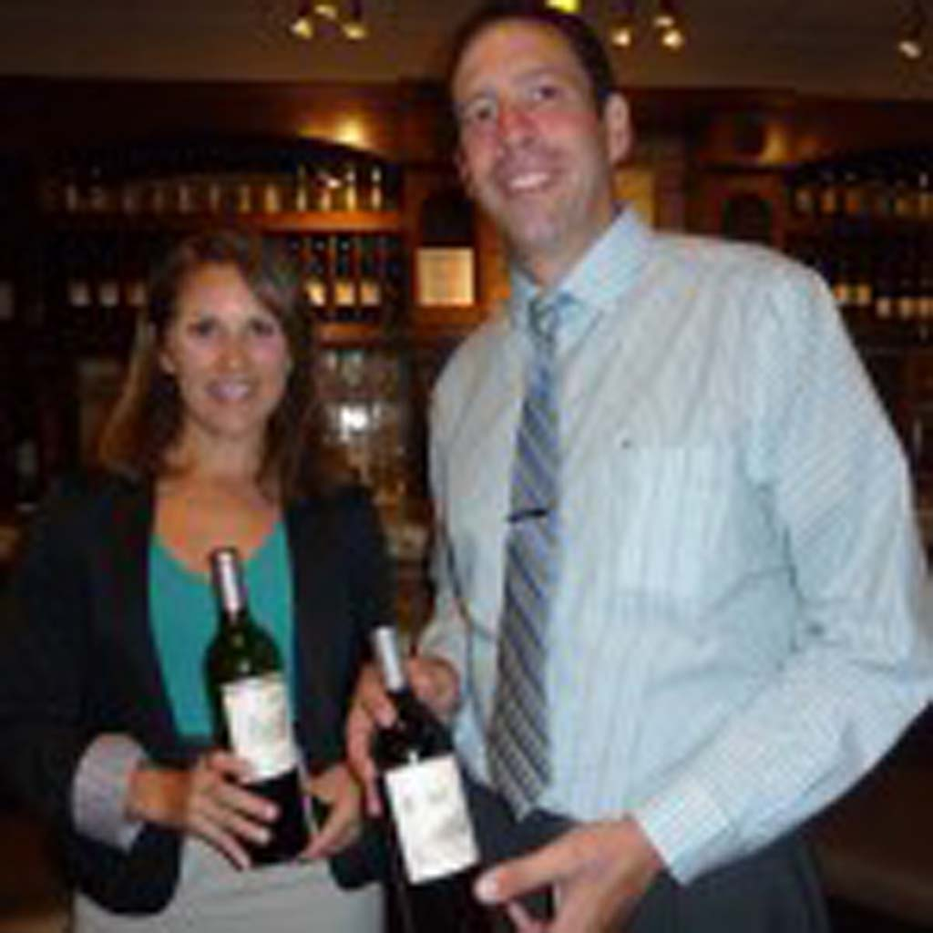 Tanya Beers of Simi Wines in Sonoma presents her selections to Chris Guillet, manager of La Gran Terraza Restaurant on campus at the University of San Diego. Photo by Frank Mangio