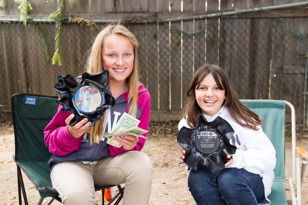 Leucadia residents Reily Allen and Casey Stilley made some cash selling their recycled album art. Photo by Daniel Knighton