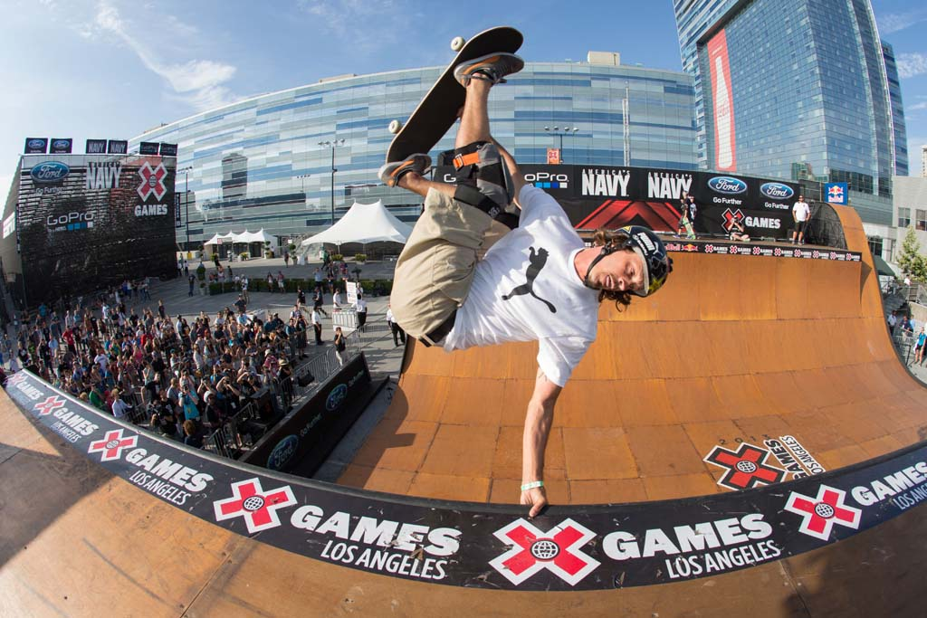 Encinitas skateboarder Bucky Lasek handplants on a halfpipe at the X-Games. His recent win this past Saturday means he's taken home four gold medals in a row at skateboarding events this year. Photo by Bryce Kanights / ESPN Images