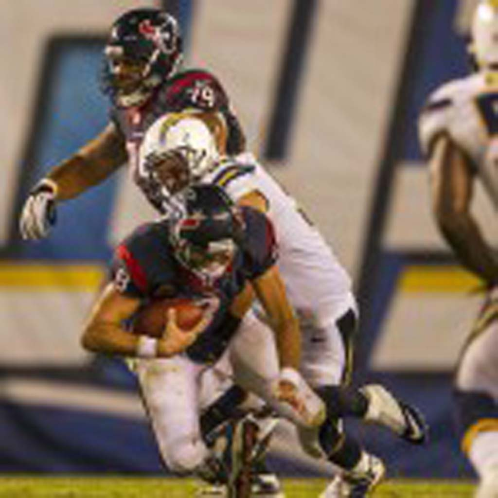 Houston Texans quarterback Matt Schaub (8) is sacked by the Chargers' Jarret Johnson. Photo by Bill Reilly