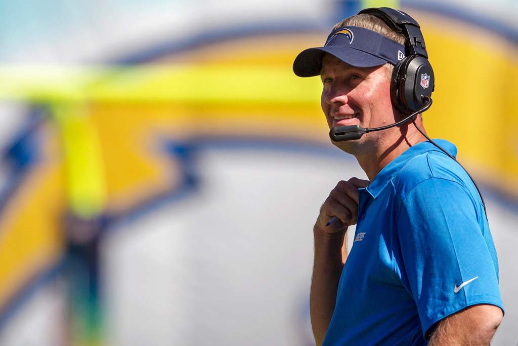 San Diego Chargers head coach Mike McCoy is all smiles as the San Diego Chargers beat the Dallas Cowboys Sunday in San Diego. Photo by Bill Reilly