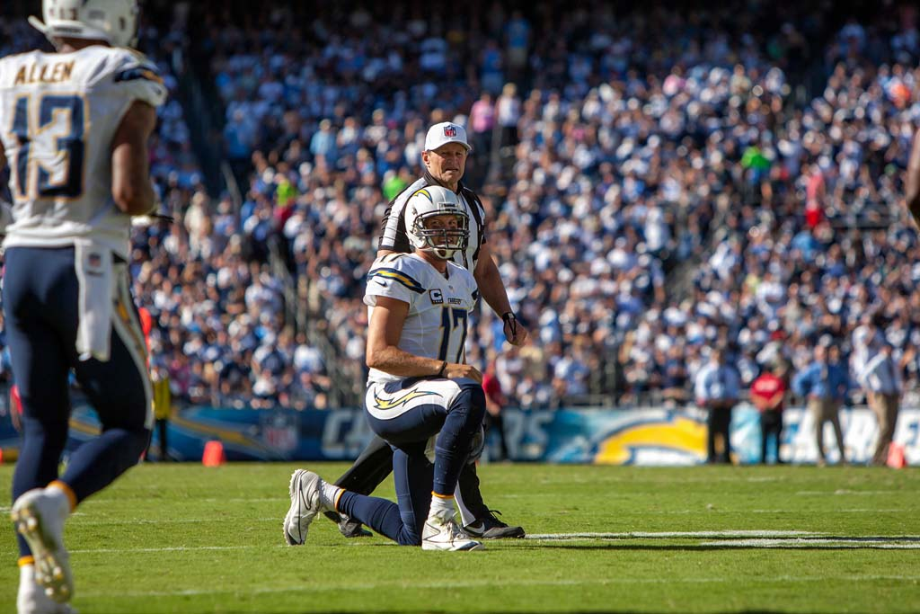Chargers quarterback Philip Rivers takes a knee after his pass to wide receiver Keenan Allen falls short during the Chargers football game against the Dallas Cowboys Sunday at Qualcomm Stadium. Photo by Bill Reilly