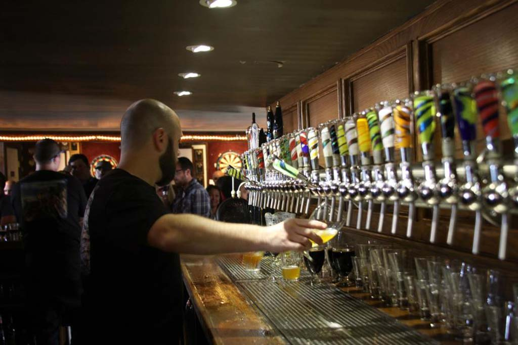 The plethora of taps makes Churchill's a beer lover's paradise. Photo courtesy of Churchill's Pub