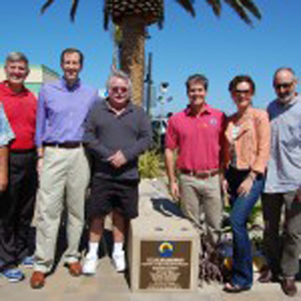 A plaque commemorating the beautification project is unveiled at the corner of Lomas Santa Fe Drive and Plaza Street. On hand are, from left, former Councilman Joe Kellejian, County Supervisor Dave Roberts, Councilmen Dave Zito and Tom Campbell, Mayor Mike Nichols, Councilwoman Lesa Heebner, Councilman Peter Zahn and City Manager David Ott. Photo by Bianca Kaplanek