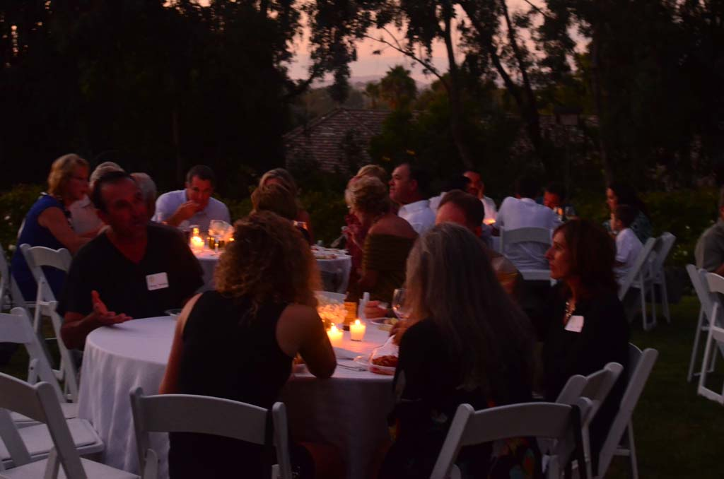 Guests enjoy food and drink during a warm September evening in Rancho Santa Fe. Photo by Tony Cagala