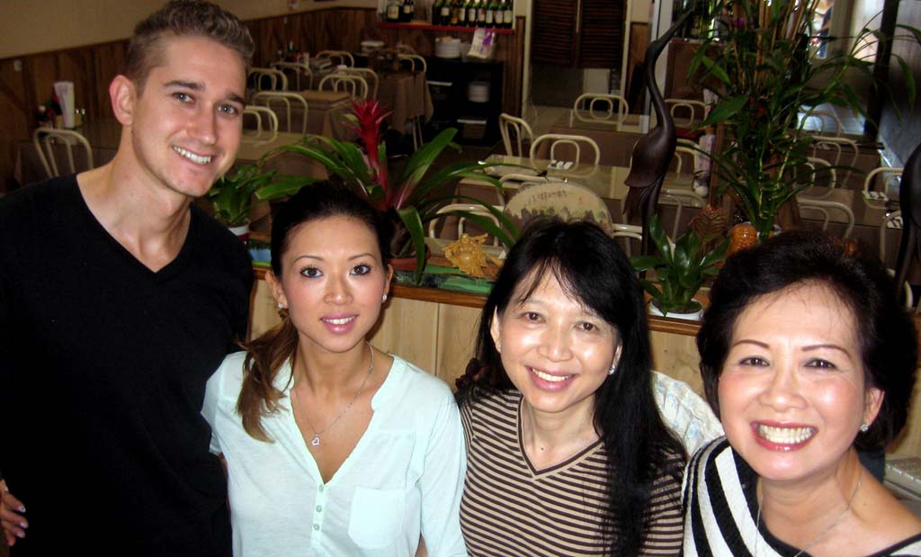 It's a family affair as Kim's Restaurant in Encinitas is turned over to a younger generation. From left, Alex Stauffer and fiancee Xuan Nguyen, new managers of Kim's Restaurant; Kim Nguyen, new owner; and Kim Doan, founding owner. Kim Nguyen is Kim Doan's younger sister and Xuan Nguyen's mother. Photo by Lillian Cox