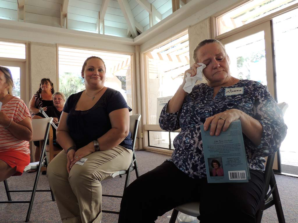 Welcome Home Ministries leader Donna Cleveland, right, wipes her eyes as she listens to women tell their stories of triumph over addiction and other struggles. Photo by Rachel Stine