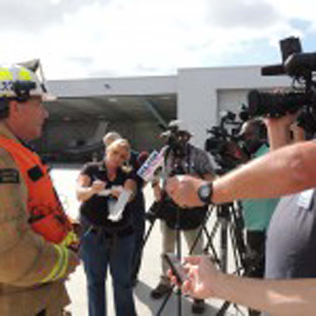 Carlsbad Fire Division Chief Mike Davis briefs the media about the emergency drill.