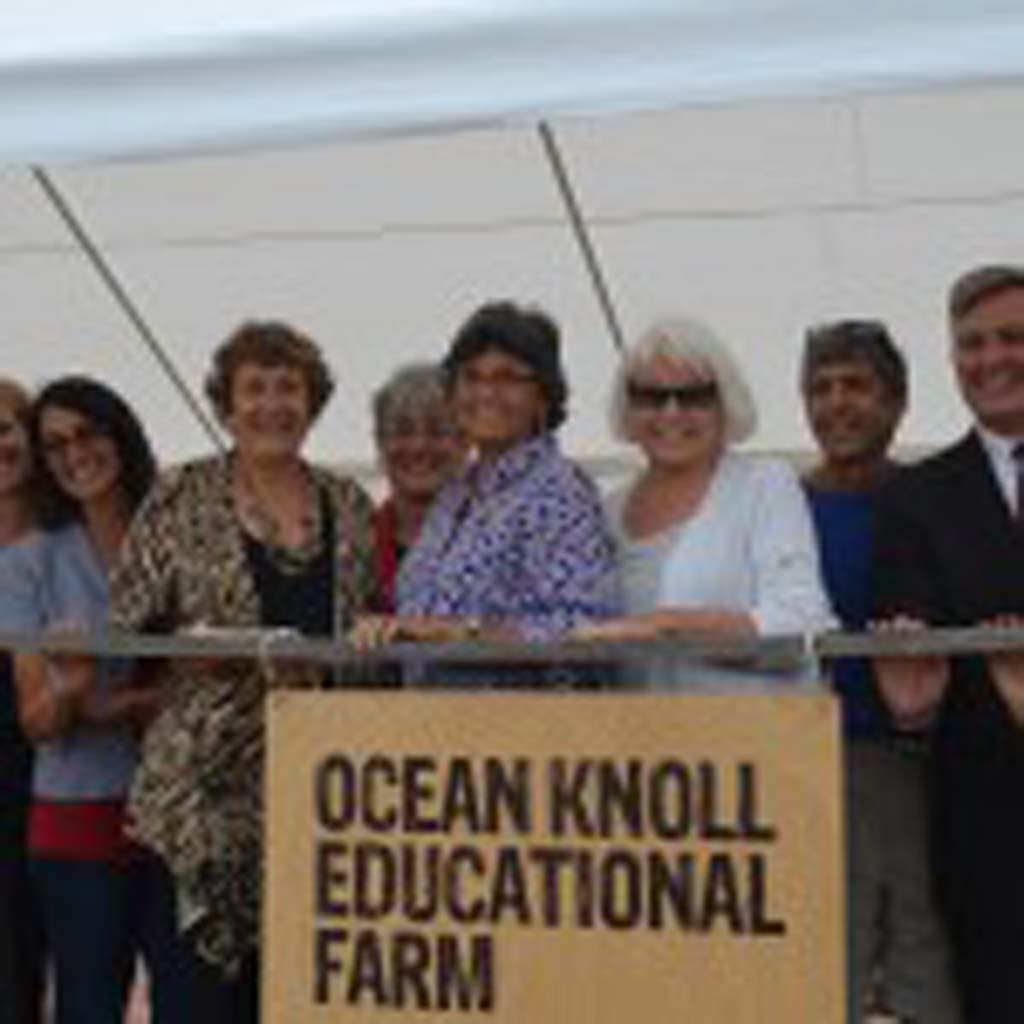 Various officials attended the ribbon-cutting ceremony. From left: EUSD Assistant Superintendent of Business Services Leighangela Brady, Mim Michelove, EUSD Trustee Marla Strich, Deputy Mayor Lisa Shaffer, Mayor Teresa Barth, EUSD Trustee Carol Skiljan, Jimbo's owner Jimbo Someck, San Diego Supervisor Dave Roberts, Chuck Matthews, the deputy director San Diego Health and Human Services and Camille Sowinski. Photo by Jared Whitlock
